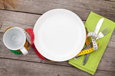 Plate with measure tape, cup, knife and fork. — Stock Photo