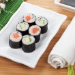 Постер, плакат: Maki sushi with sakura branch
