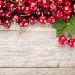 Cherries on wooden table — Stock Photo #48929677