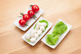 Tomatoes, mozzarella and  salad — Stock Photo