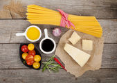 Parmesan cheese, pasta, tomatoes — Stock Photo