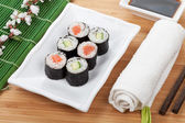 Maki sushi  with sakura branch — Stock Photo