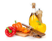 Peppers and kitchen utensils — Stock Photo