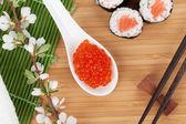Sushi set and sakura branch — Zdjęcie stockowe