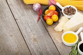 Herbs, spices, tomatoes and cheese — Stock Photo