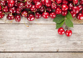 Cherries on wooden table — Stock Photo