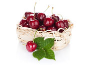 Ripe cherries in basket — Stock Photo
