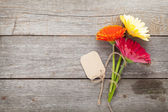 Flowers with tag — Stock Photo
