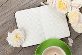Blank notepad coffee cup and flowers — Stock Photo