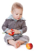 Small baby with red apple — Stock Photo