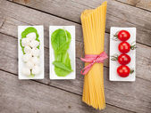 Tomatoes, mozzarella, pasta — Stock Photo