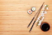 Maki sushi and chopsticks — Stock Photo