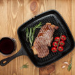 Sirloin steak on frying pan — Stock Photo #49994071