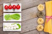 Tomatoes, mozzarella and pasta — Stock Photo