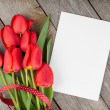 Fresh tulips bouquet and blank card for copy space — Stock Photo #50287267