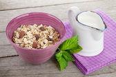Healty breakfast with muesli and milk — Stock Photo
