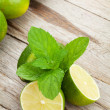 Fresh ripe limes with mint — Stock Photo