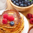 Pancakes with raspberry, blueberry, mint and honey syrup — Stock Photo #50923239