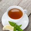 Green tea with lemon and mint — Stock Photo