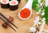Red caviar, sushi set, sakura — Stock Photo
