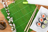 Sushi set, chopsticks and sakura — Stock Photo