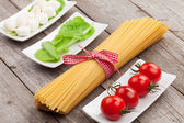 Tomatoes, mozzarella, pasta and salad leaves — Stock Photo