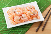 Cooked shrimps and chopsticks — Stock Photo