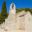 Small rural stone church — Stock Photo