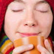 Stock Photo: Pretty smiling girl in winter clothes with cup of hot drink