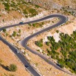 Aerial view of a mountain lacet road - Stock Photo