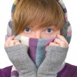 Pretty girl in winter clothes covering her face with warm scarf — Stok Fotoğraf #14147908