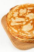 Stack of pancakes isolated on white background — Stock Photo