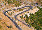 Aerial view of a mountain lacet road — Stock Photo