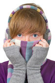 Pretty girl in winter clothes covering her face with warm scarf — Stok fotoğraf