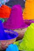 Colorful piles of powdered dyes used for Holi festival in India — ストック写真