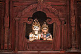 Shiva and Parvati wooden figures in the window of Shiva Parvati Hindu temple at Durbar Square — Stock Photo