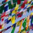 Buddhist Tibetan prayer flags against blue sky — Stok fotoğraf