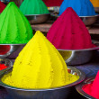 Colorful piles of powdered dyes used for Holi festival in India - Stok fotoğraf