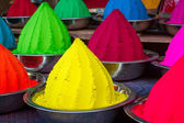 Colorful piles of powdered dyes used for Holi festival in India — Stockfoto