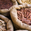 Cinnamon and other spices in the bags at Indian market — Stock Photo