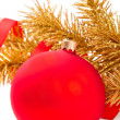 Golden christmas ball on golden fir-tree branch — Stock Photo
