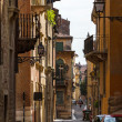Old narrow street in the small Italian town — Stock Photo
