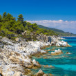 Rocky coastline and a beautiful clear water at Halkidiki Kassand — Stock Photo