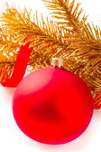 Golden christmas ball on golden fir-tree branch — Stock Photo