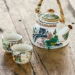 Chinese porcelain teapot and two cups on a wooden table — Stock Photo #38475995