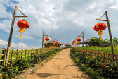Red Chinese lanterns along the rural road — Stock Photo