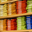 Neat stacks of folded clothing on shop shelves — Stock Photo #41904019