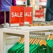 Stock Photo: Sale sign in clothing shop