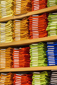 Neat stacks of folded clothing on the shop shelves — Foto Stock