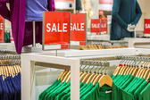 Sale sign in the clothing shop — Stock Photo